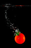 Tomato sinking in water Stock Image