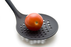 Tomato on skimmer Stock Photos