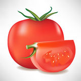 Tomato and slice Royalty Free Stock Photography
