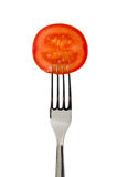 Tomato slice on fork Royalty Free Stock Photos