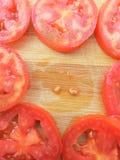 Tomato slice frame on wooden background Stock Image