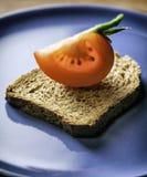 Tomato slice. Fresh tomato slice on bread Royalty Free Stock Image