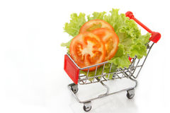 Tomato slice and lettuce in shopping cart Stock Images