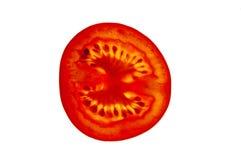 Tomato slice macro detail. Slice tomato backlit detail isolated on white to shoe inside stock photo