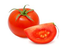 Tomato and a slice of tomato. stock images