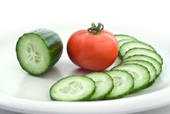 Tomato and sliced cucumber Stock Images