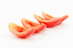 Tomato sliced ingredient without seed  on white background Stock Image