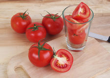 Tomato and sliced tomato prepare on the wood table Stock Image