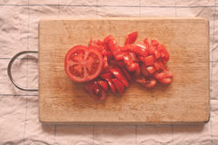 Tomato. Sliced tomato on a wooden board Royalty Free Stock Image