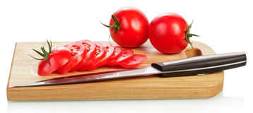 Tomato slices on cutting board Royalty Free Stock Photography
