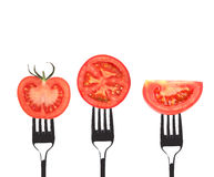 Tomato slices on forks. Royalty Free Stock Photo
