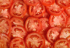 Tomato slices. Natural background with slices of tomato Stock Photography