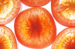 Tomato slices in water with bubbles Royalty Free Stock Photo