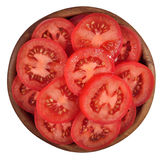 Tomato slices in a wooden bowl on a white stock photo