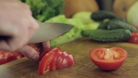 Tomato slicing on chopping board stock video footage