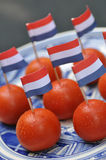 Tomato snack. Dutch snack tomato with flag Royalty Free Stock Photo