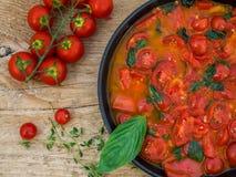 Tomato souce for pasta. Fresh tomato sause for pasta on a wooden desk Stock Photo