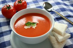 Tomato Soup 1. A bowl of tomato soup garnished with cream and herbs stock photo