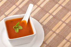 Tomato soup. In bowl on hand made background Royalty Free Stock Images