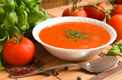 Tomato soup. In a bowl with healthy and fresh ingredients and herbs Royalty Free Stock Image