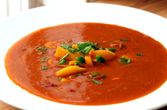Tomato Soup. With vegetable garnish close-up on white plate Royalty Free Stock Photos