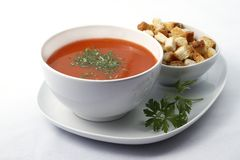 Tomato soup. A delicious meal of tomato soup topped with fresh parsley and croutons. Raw available stock photos