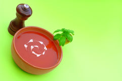 Tomato Soup. Fresh healthy tomato soup garnished with heart shaped cream drops and basil Stock Photo