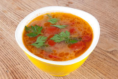 Tomato soup. In a yellow bowl Royalty Free Stock Photos