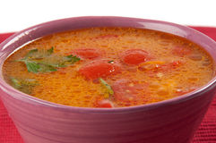 Tomato soup. In a lilac bowl Royalty Free Stock Images