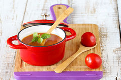 Tomato soup. With basil on wooden board Royalty Free Stock Photography