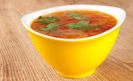 Tomato soup. In a yellow bowl Stock Photos