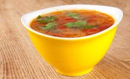 Tomato soup. In a yellow bowl Stock Photos
