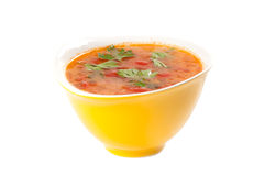 Tomato soup. In a yellow bowl on a white background Stock Photography
