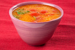Tomato soup. In a lilac bowl Stock Photo