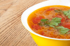 Tomato soup. In a yellow bowl Stock Images