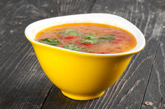 Tomato soup. In a yellow bowl Stock Photo