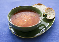 Tomato soup. Homemade tomato soup served in green bowl royalty free stock image