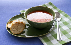 Tomato soup. Homemade tomato soup in green bowl stock images