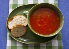 Tomato soup. Homemade tomato soup served in green bowl stock image