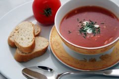 Tomato soup. A bowl of tomato soup served with bread stock image