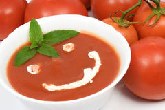 Tomato soup. With basil leafs and sour cream as decoration Stock Images