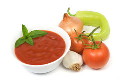 Tomato soup. With vegetables isolated on white Stock Photography