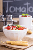 Tomato soup with baked tomatoes and breadsticks Stock Images