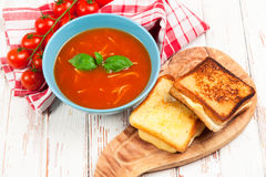 Tomato soup and basil Stock Photos