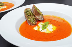 Tomato soup with basil and cream Stock Photo