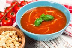 Tomato soup and basil Stock Images