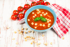 Tomato soup and basil Stock Photo