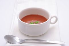 Tomato soup with basil garnish Stock Photos
