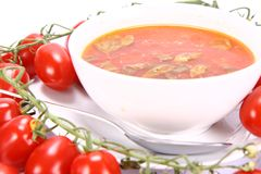 Tomato soup with basil leaves Royalty Free Stock Image