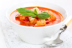 Tomato soup with basil leaves Stock Photo